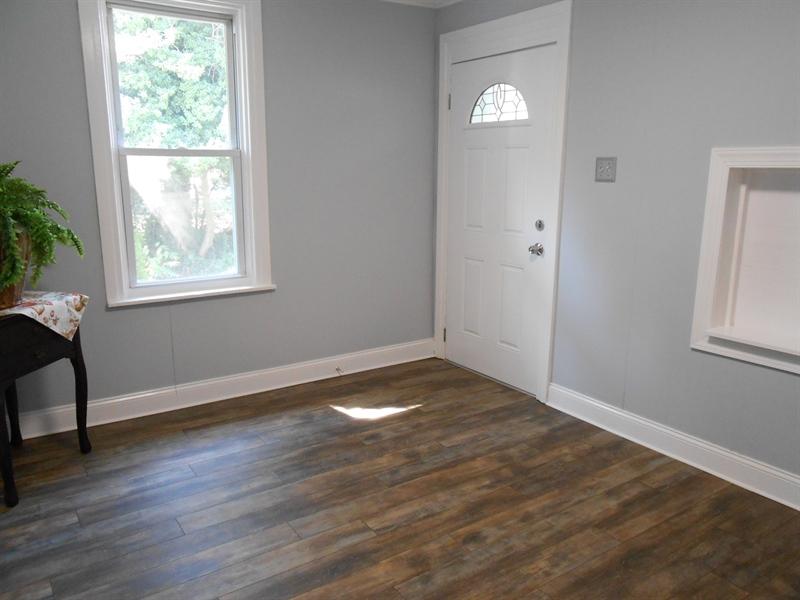 Real Estate Photography - 1706 Walnut Street Street, Wilimington, DE, 19809 - Living Room W/ Laminate Flooring