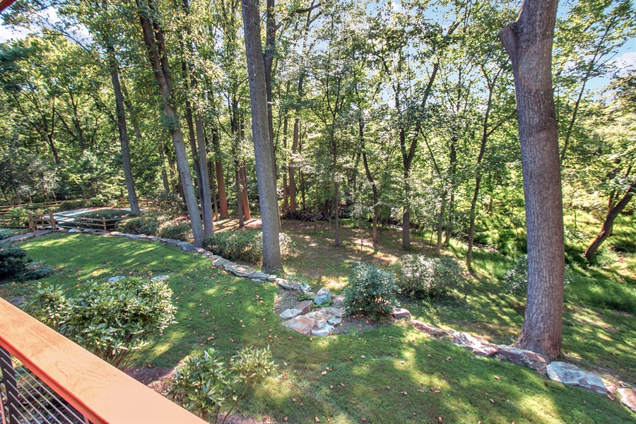 Real Estate Photography - 102 S Kildonan Gln, Wilmington, DE, 19807 - Rear Boulder Wall Supported Green Space