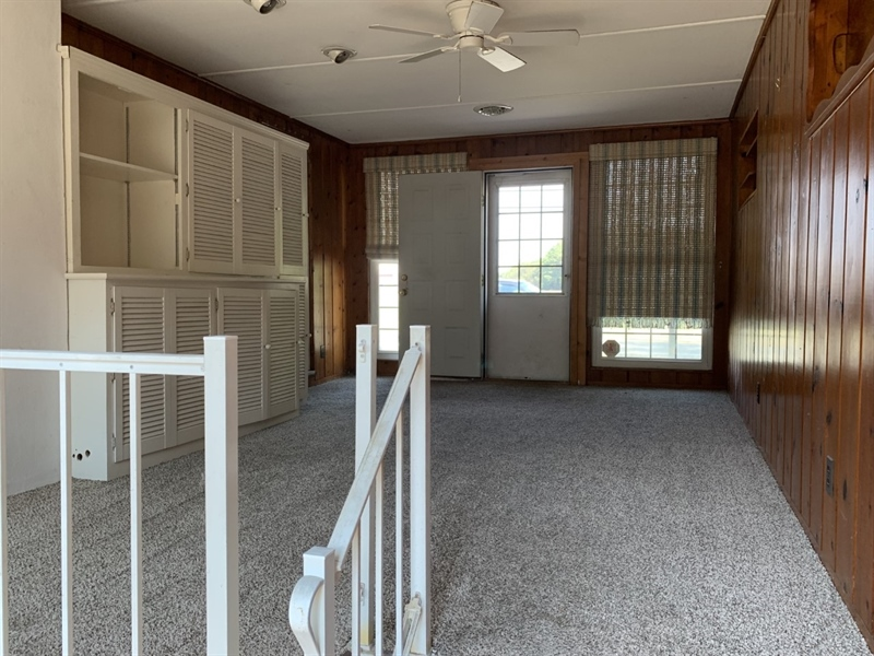 Real Estate Photography - 26170 Cave Neck Rd, Milton, DE, 19968 - family room with walk-down to basement