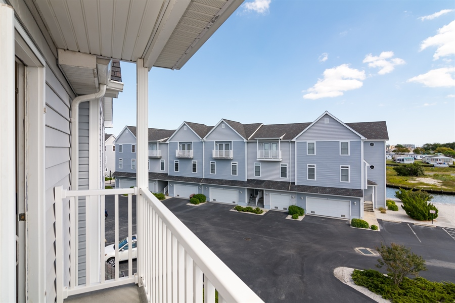 Real Estate Photography - 39035 Beacon Drive #5, 5, Fenwick Island, DE, 19944 - Front balcony overlooking canal