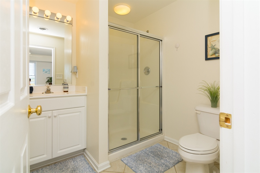 Real Estate Photography - 39035 Beacon Drive #5, 5, Fenwick Island, DE, 19944 - Full bathroom adjacent to 1st Floor BR