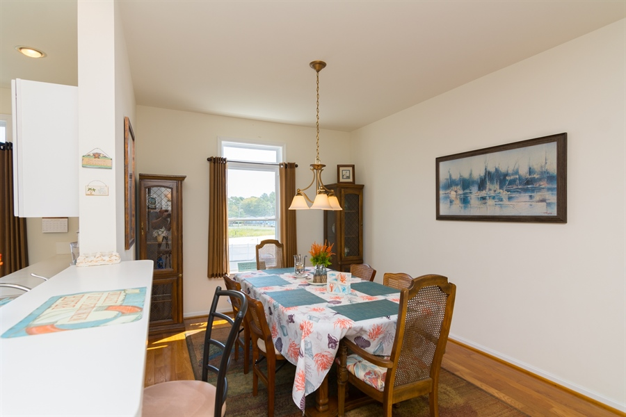 Real Estate Photography - 39035 Beacon Drive #5, 5, Fenwick Island, DE, 19944 - Dining Room directly off of kitchen