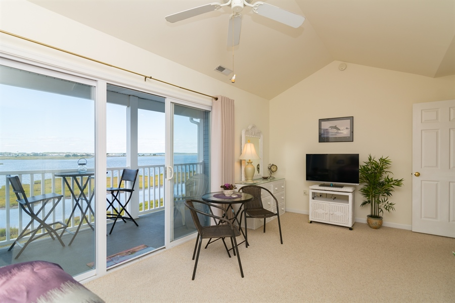 Real Estate Photography - 39035 Beacon Drive #5, 5, Fenwick Island, DE, 19944 - Sliders lead to your private deck w/stunning views