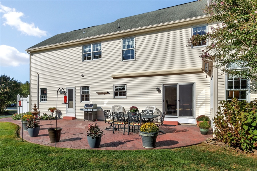 Real Estate Photography - 303 Wyndtree Ct N, Hockessin, DE, 19707 - Beautiful Patio With Retractable Awning