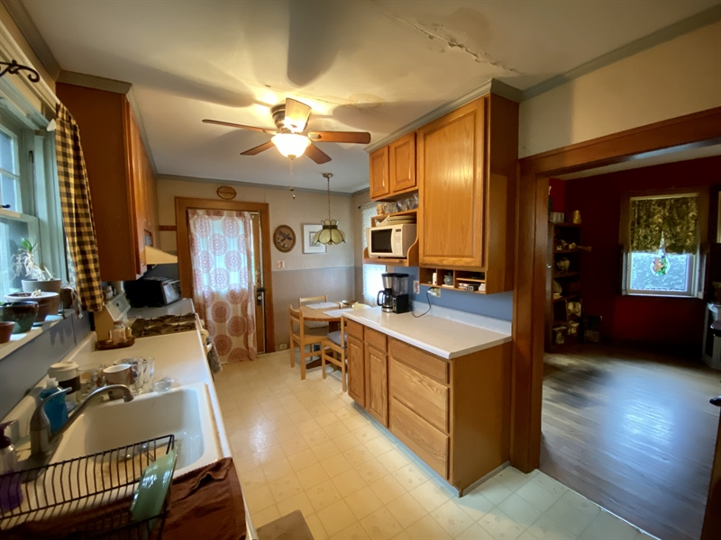 Real Estate Photography - 2327 Pennsylvania Ave, Wilmington, DE, 19806 - Kitchen Open to Dining Room