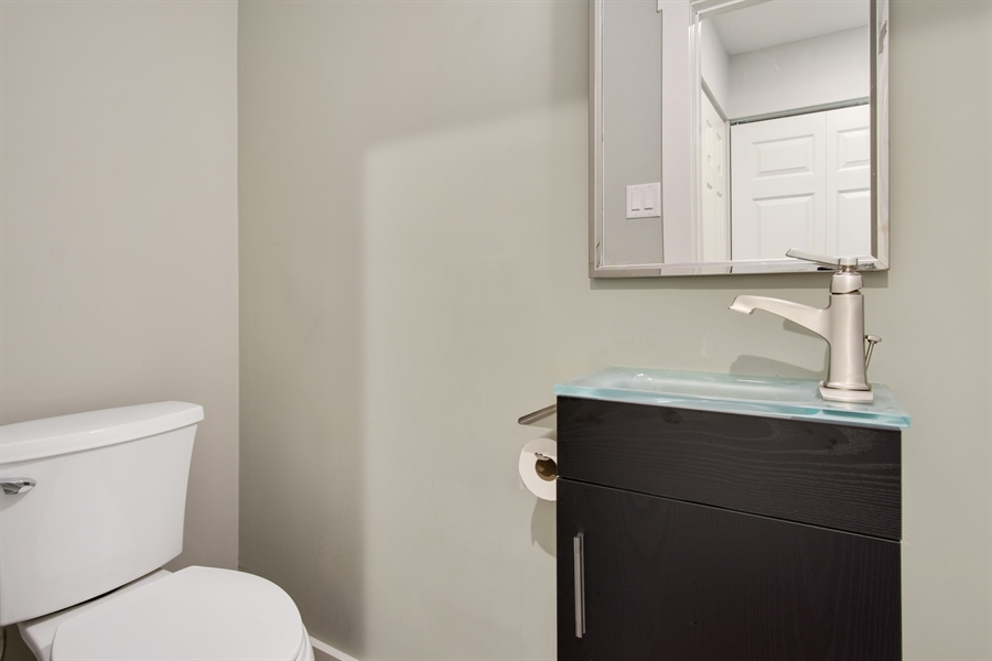 Real Estate Photography - 29 Patrick Henry Ct, Newark, DE, 19711 - Remodeled Powder Room with Kohler Fixtures