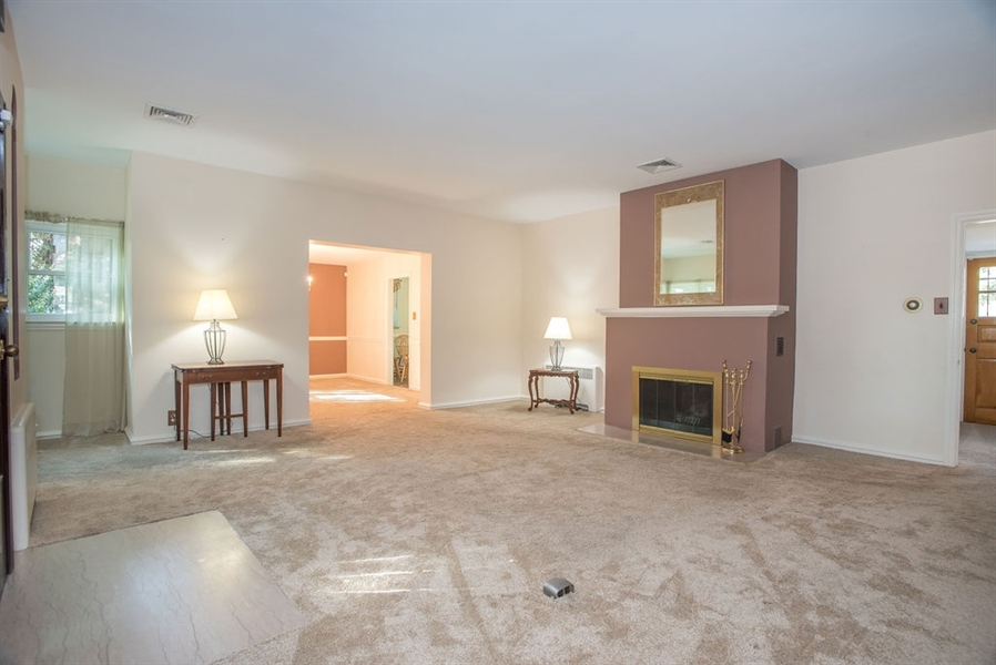 Real Estate Photography - 1817 Linden St, Wilmington, DE, 19805 - Living Room w Fireplace into Dining Room
