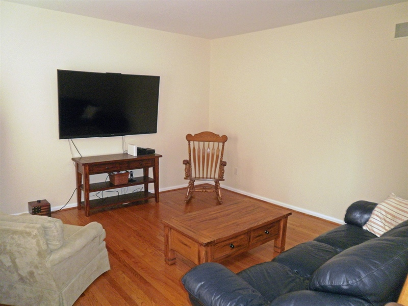 Real Estate Photography - 15 Mica St, Townsend, DE, 19734 - Living room with hardwood floors & fresh paint