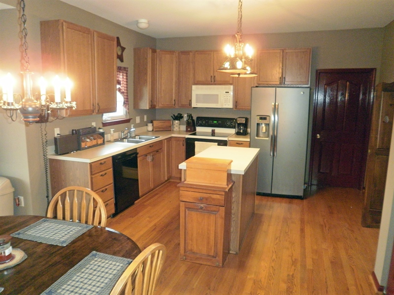 Real Estate Photography - 15 Mica St, Townsend, DE, 19734 - Island, Hardwood floors, appliances in the kitchen