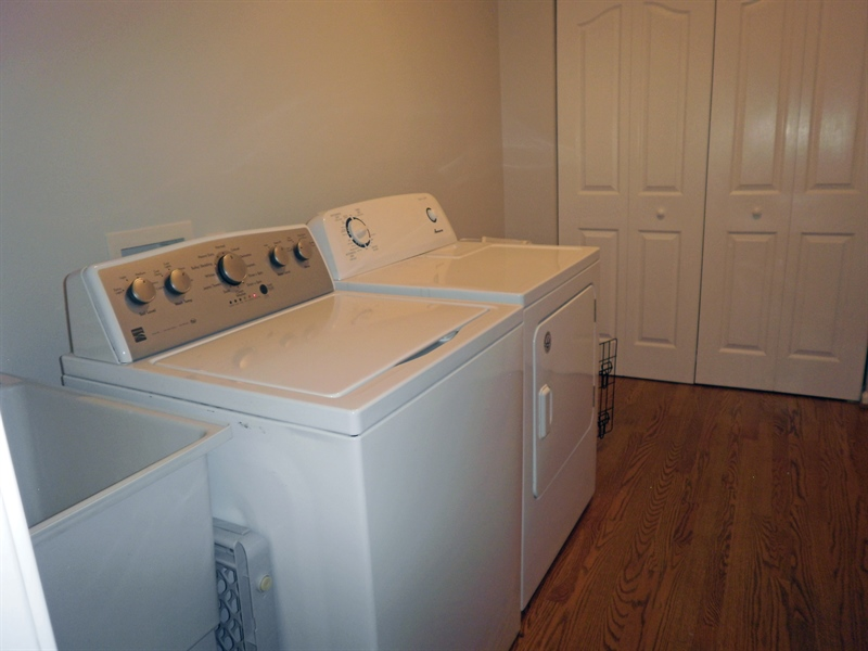 Real Estate Photography - 15 Mica St, Townsend, DE, 19734 - Hardwood floors,washer & dryer included in laundry