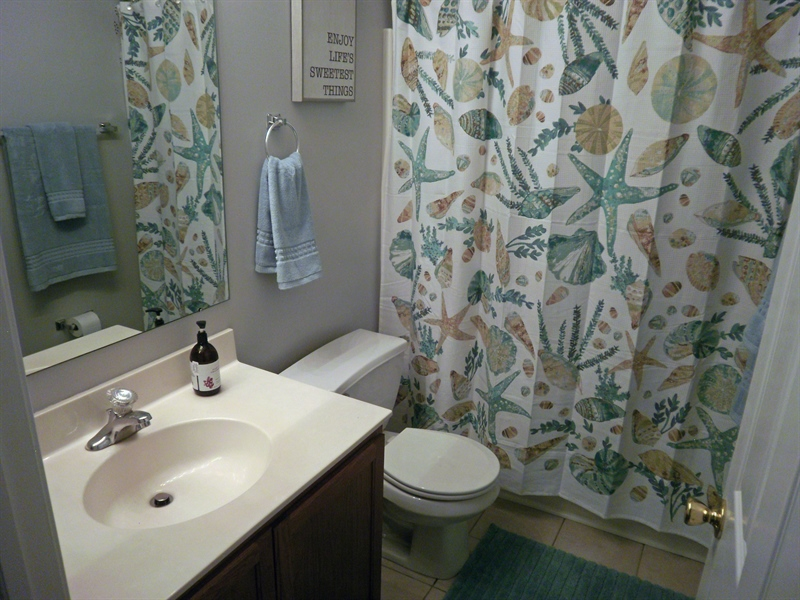 Real Estate Photography - 15 Mica St, Townsend, DE, 19734 - Fiberglass tub/ shower in the main bathroom