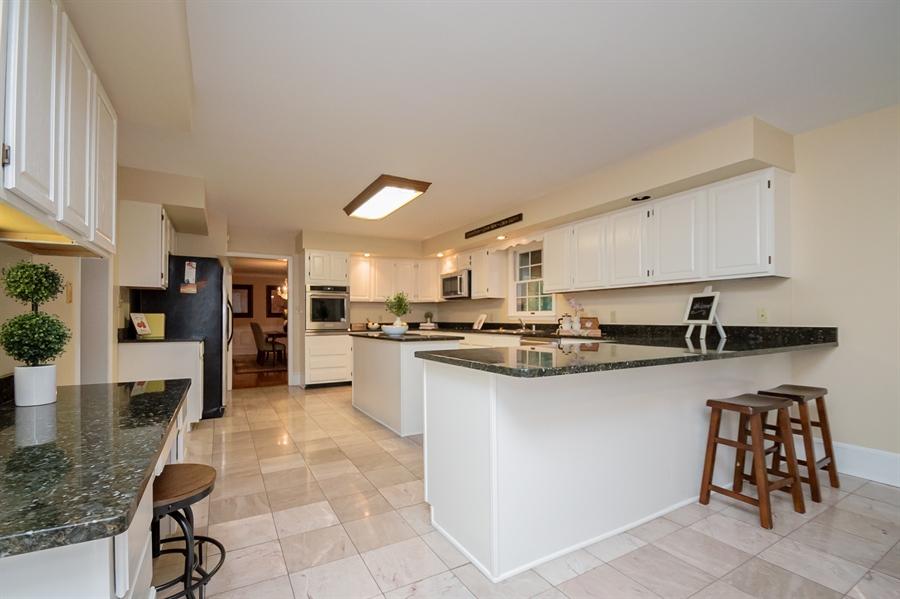 Real Estate Photography - 114 Mettenet Ct, Hockessin, DE, 19707 - Kitchen has Granite Countertops