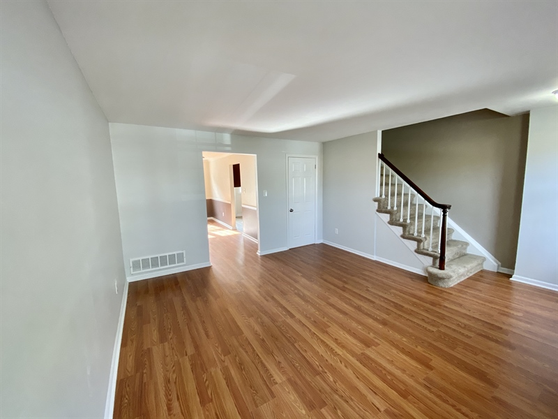 Real Estate Photography - 306 9th Ave, Wilmington, DE, 19805 - Living Room Opens to Dining Room