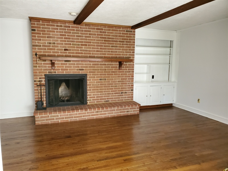 Real Estate Photography - 615 Berwick Rd, Wilmington, DE, 19803 - Family room with built in book shelves