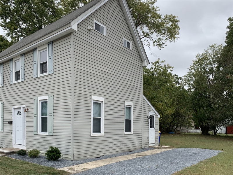 Real Estate Photography - 114 Mechanic St, Harrington, DE, 19952 - Side View of House from Street