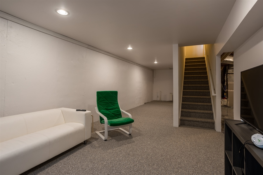 Real Estate Photography - 303 Arch St, Milton, DE, 19968 - Lower Level Rec Room