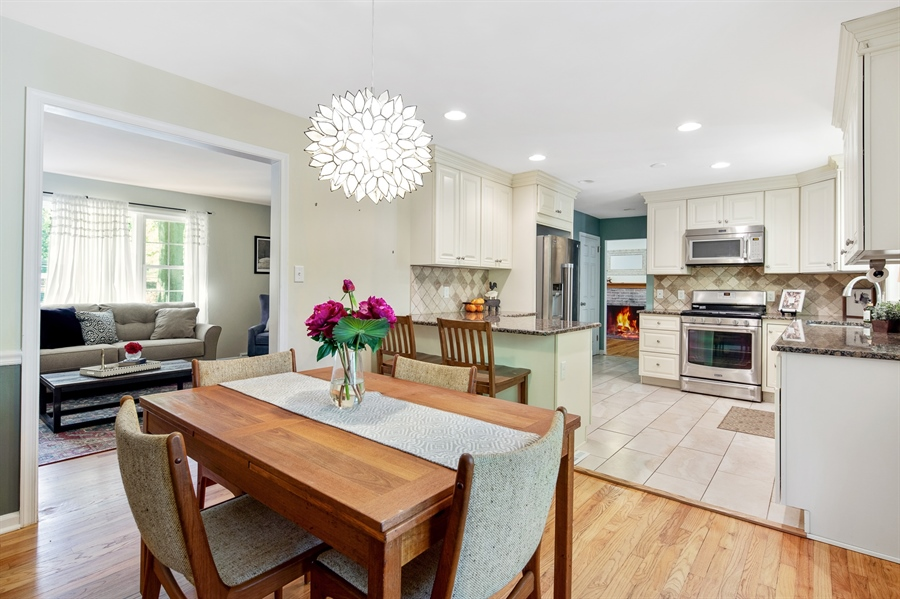 Real Estate Photography - 314 Arbour Dr, Newark, DE, 19713 - Dining Room - view of kitchen and living room