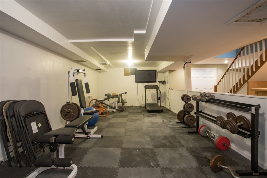 Real Estate Photography - 201 Manor Dr, Middletown, DE, 19709 - Workout Area in Basement