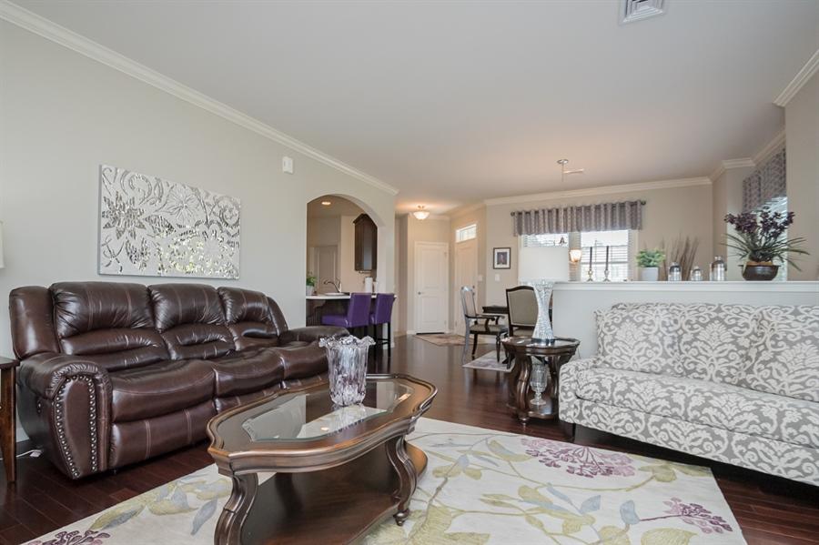 Real Estate Photography - 143 Honeycroft Blvd Boulevard, Cochranville, DE, 19330 - Living Room with gleaming Hardwood Floors