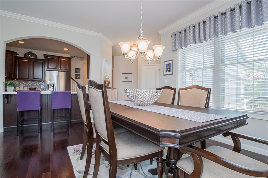 Real Estate Photography - 143 Honeycroft Blvd Boulevard, Cochranville, DE, 19330 - Dining Area and Kitchen Bar Seating