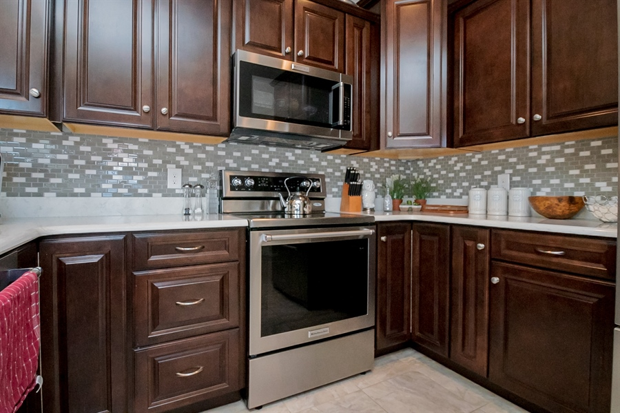 Real Estate Photography - 143 Honeycroft Blvd Boulevard, Cochranville, DE, 19330 - Stainless Steel Appliances; Tile Backsplash