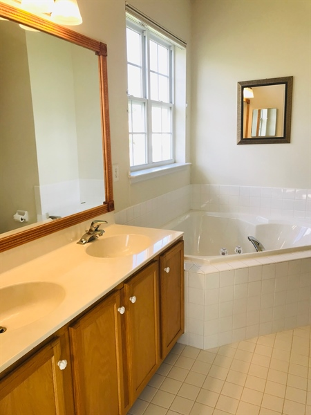 Real Estate Photography - 572 Whispering Trl, Middletown, DE, 19709 - Master bath with soaking tube