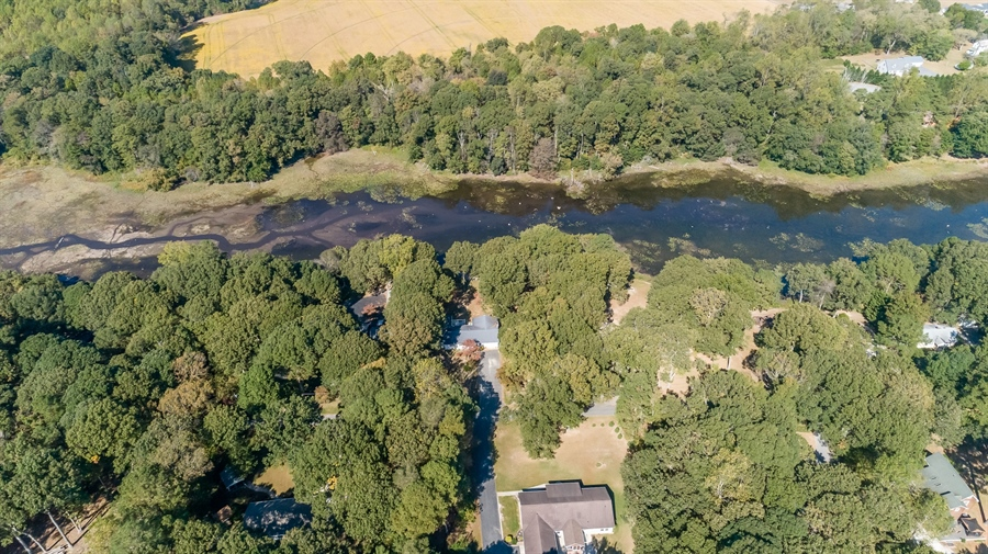 Real Estate Photography - 20 Water St, Lincoln, DE, 19960 - AERIAL VIEW OF THE HOME ACROSS STREET FROM POND