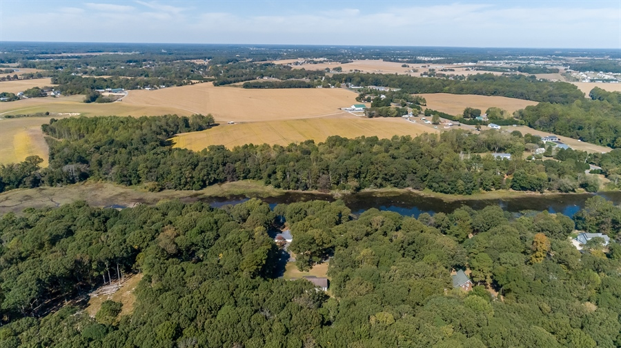 Real Estate Photography - 20 Water St, Lincoln, DE, 19960 - AERIAL OF THE AREA AROUND THE POND
