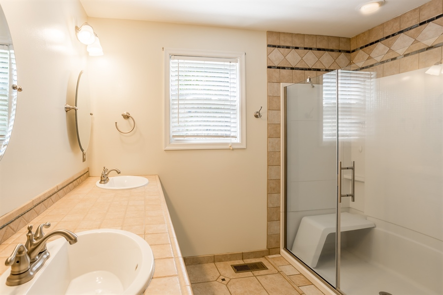 Real Estate Photography - 20 Water St, Lincoln, DE, 19960 - MAIN BEDROOM BATHROOM WITH NEW TILED SHOWER