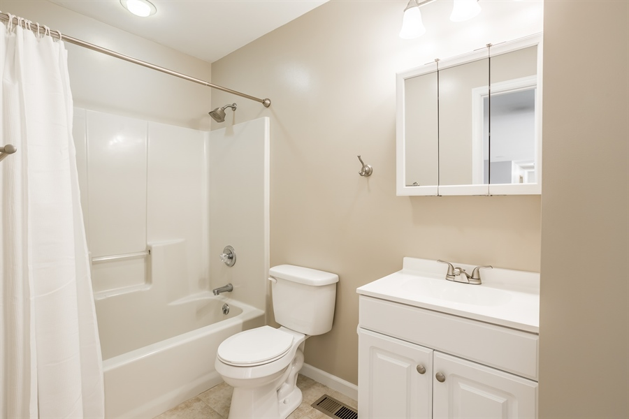 Real Estate Photography - 20 Water St, Lincoln, DE, 19960 - RENOVATED HALL BATHROOM