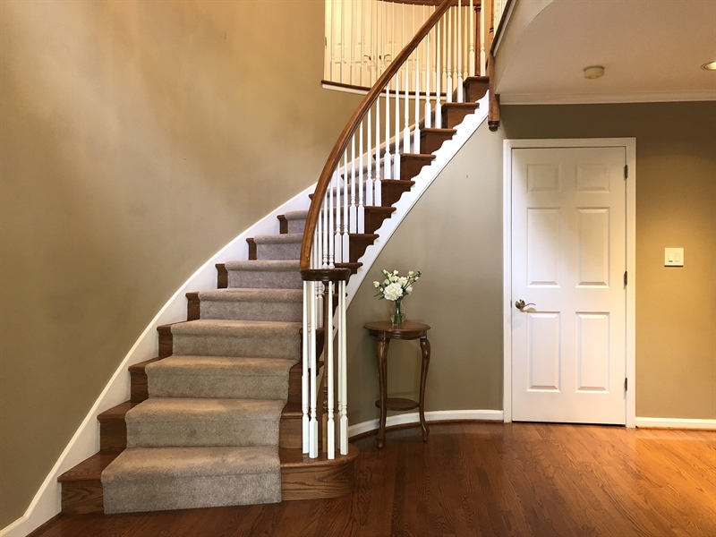 Real Estate Photography - 4919 Lancaster Pike, Wilmington, DE, 19807 - Elegant curved staircase and two story foyer