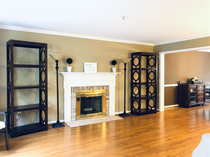 Real Estate Photography - 4919 Lancaster Pike, Wilmington, DE, 19807 - Large living room w/fireplace, open to dining room