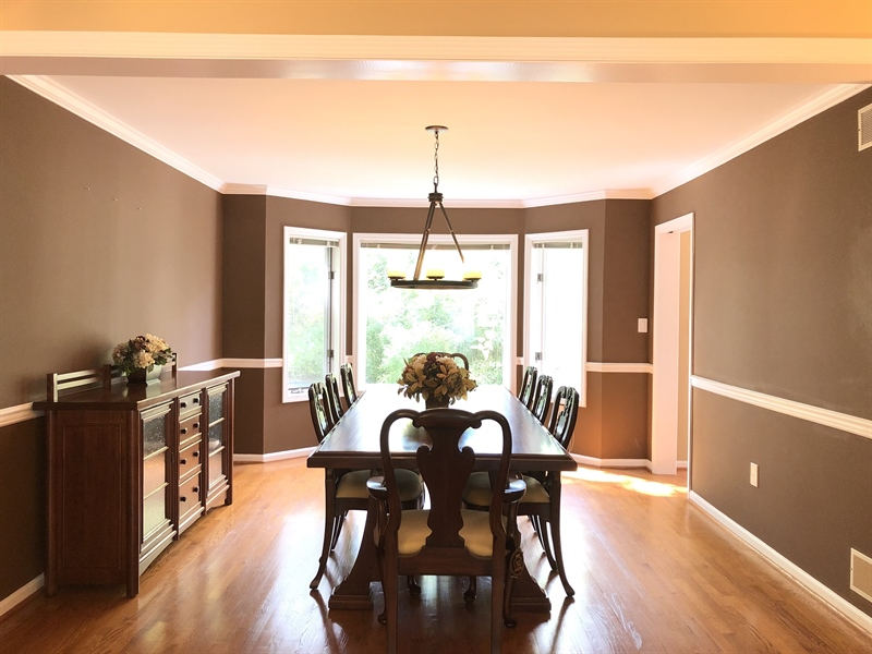 Real Estate Photography - 4919 Lancaster Pike, Wilmington, DE, 19807 - Dining room with chair rail & crown molding