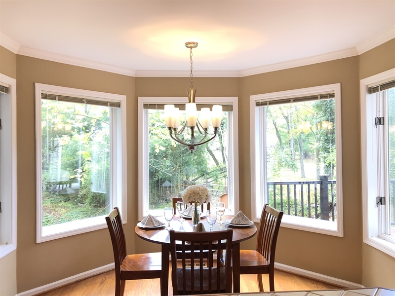 Real Estate Photography - 4919 Lancaster Pike, Wilmington, DE, 19807 - Sunny breakfast room has tranquil views