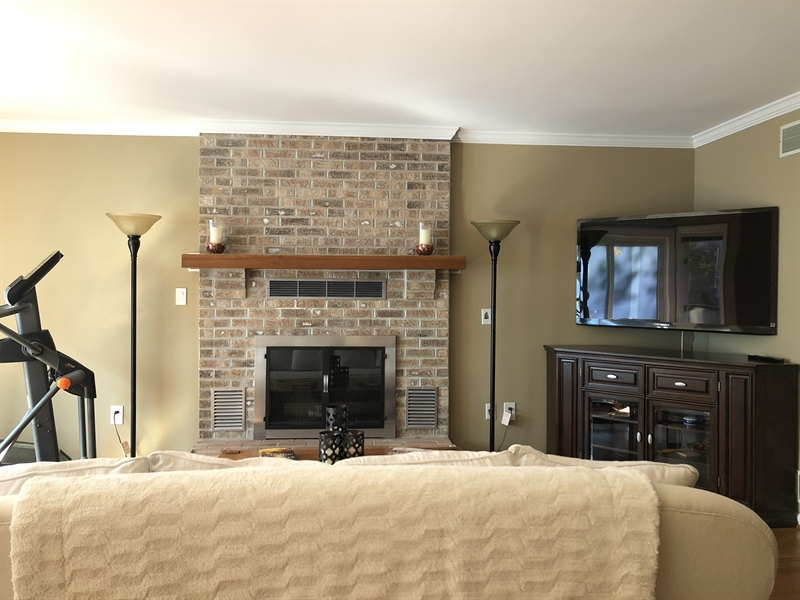 Real Estate Photography - 4919 Lancaster Pike, Wilmington, DE, 19807 - Brick wood burning fireplace for cozy evenings