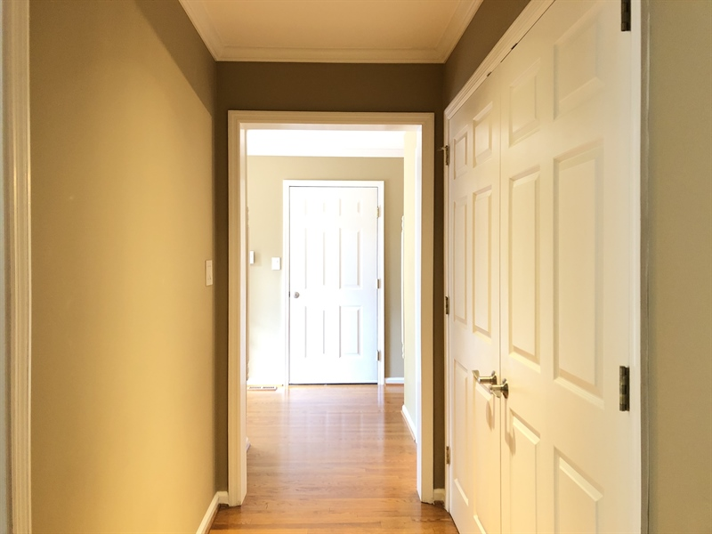 Real Estate Photography - 4919 Lancaster Pike, Wilmington, DE, 19807 - Hallway w/ large closet leads to entry from garage