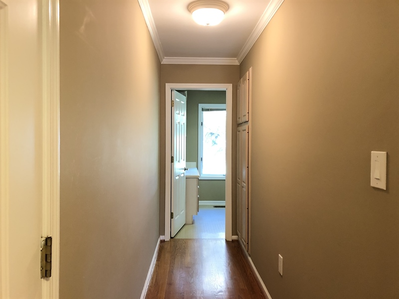 Real Estate Photography - 4919 Lancaster Pike, Wilmington, DE, 19807 - Hallway with more storage leads to...