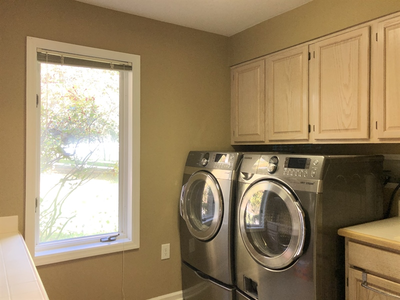Real Estate Photography - 4919 Lancaster Pike, Wilmington, DE, 19807 - Fabulous laundry room w/ sink & lots of cabinetry