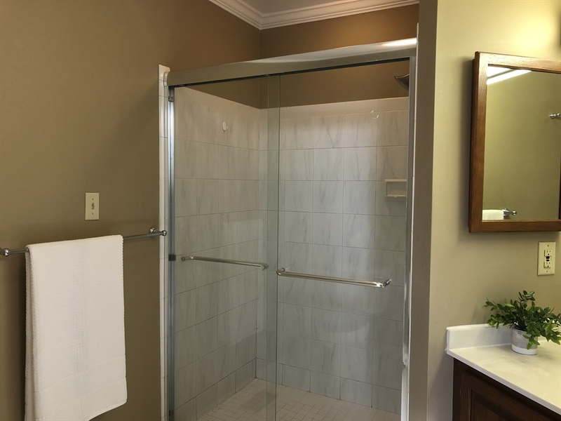 Real Estate Photography - 4919 Lancaster Pike, Wilmington, DE, 19807 - Private bath w/ stall shower & another vanity