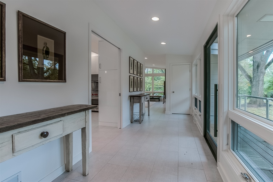 Real Estate Photography - 112 S Spring Valley Rd, Greenville, DE, 19807 - Foyer to Kitchen, Family Room & Living Room