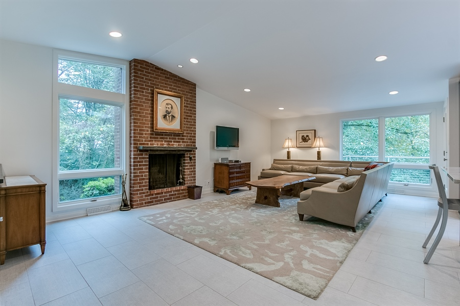 Real Estate Photography - 112 S Spring Valley Rd, Greenville, DE, 19807 - Wood Burning Fireplace in Family Room