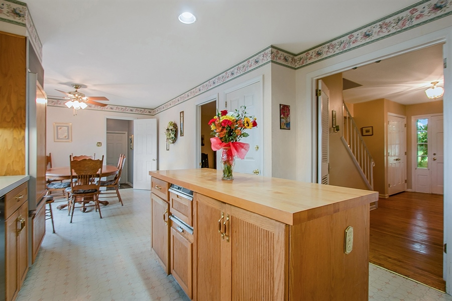 Real Estate Photography - 109 Foxbrook Dr, Landenberg, PA, 19350 - Kitchen island with view to table area