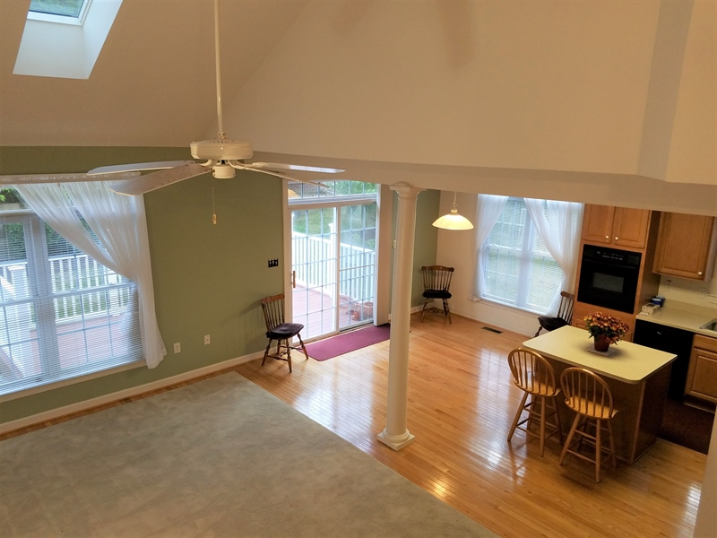 Real Estate Photography - 351 Regis Falls Ave, Wilmington, DE, 19808 - Open living room & kitchen w/ access to rear deck