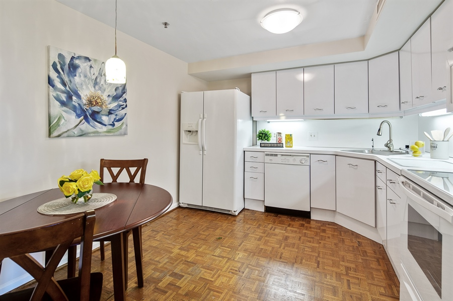 Real Estate Photography - 1100 Lovering Avenue #1100, 1100, Wilmington, DE, 19806 - Eat-in Kitchen with Under cabinet lighting