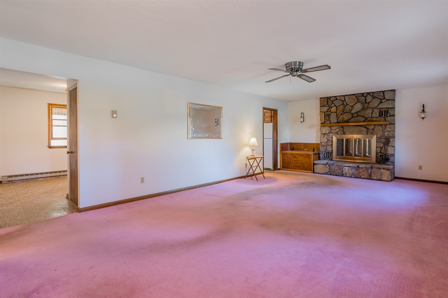 Real Estate Photography - 22650 Dorman Rd, Lewes, DE, 19958 - Den with wood burning fireplace