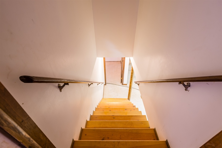 Real Estate Photography - 22650 Dorman Rd, Lewes, DE, 19958 - Interior stairs to basement