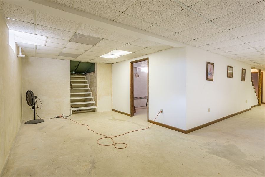 Real Estate Photography - 22650 Dorman Rd, Lewes, DE, 19958 - Basement with stairs to outside