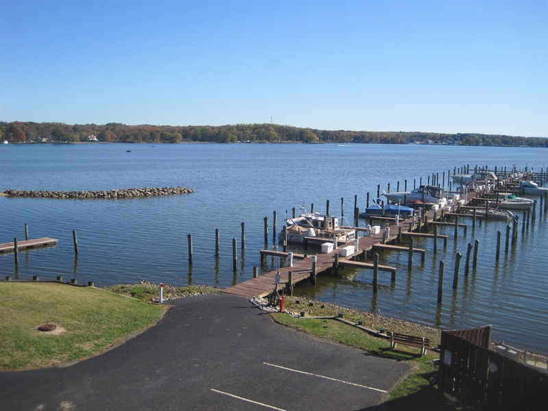 Real Estate Photography - 21 B North East Isles Drive, North East, DE, 21901 - view of pier from deck