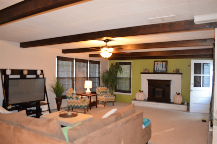 Real Estate Photography - 119 S Dillwyn Rd, Newark, DE, 19711 - Gas Fireplace and Beams in Family Room