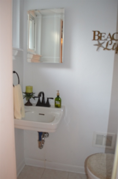 Real Estate Photography - 119 S Dillwyn Rd, Newark, DE, 19711 - Powder Room off of Family Room